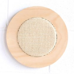 Round cat scratcher on wall