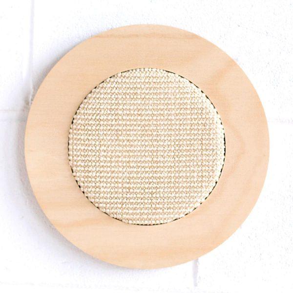 Round cat scratcher on wall