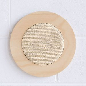 natural flat out scratcher attached to wall