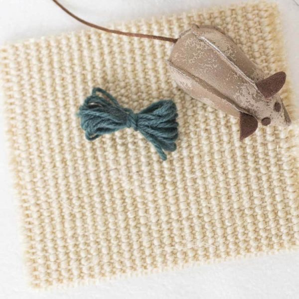 Woven square of cat scratching material with mouse and green wool