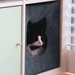 Cat sleeping in grey cat cave