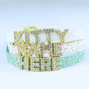 Three cat collars with the words KITTY NAME HERE