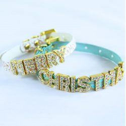 Two cat collars with the words MERRY CHRISTMAS