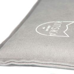 Corner of grey cat bed